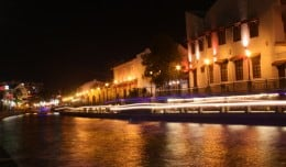 The light-trails of a boat are seen against the backdrop of restored buildings in Chinatown, Malacca, Malaysia.