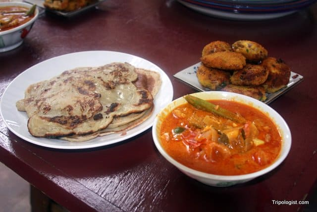 The finished products: banana pancakes, fish curry, and chicken cutlets.