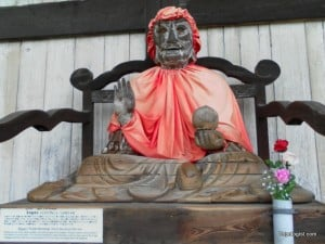 An odd looking statue sitting outside of Todaiji Temple in Nara Park.