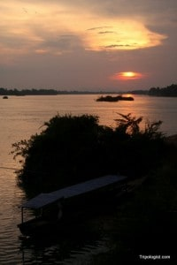 The sun sets over the Mekong River on Don Dhet in Laos.