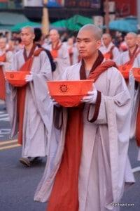 Buddhist Monks carrying lanterns during the Lotus Lantern Festival Parade.