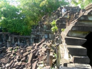 The Tripologist, top right, standing on a rooftop at Beng Mealea Temple.
