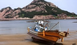 A fishing boat waits for high tide on Seonudo Island in South Korea.