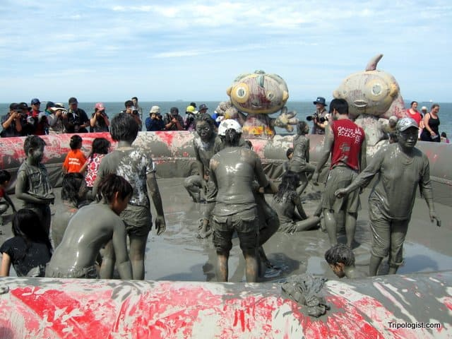 Participants getting muddy during the Boryeong Mud Festival in South Korea.
