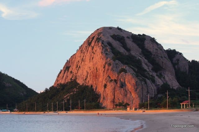 Manjubong standing guard over Seonyudo's main beach at sunset.