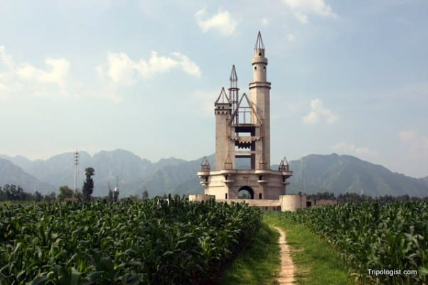 Wonderland Amusement Park's unfinished castle lies amid cornfields and in front of towering mountains outside of Beijing, China.