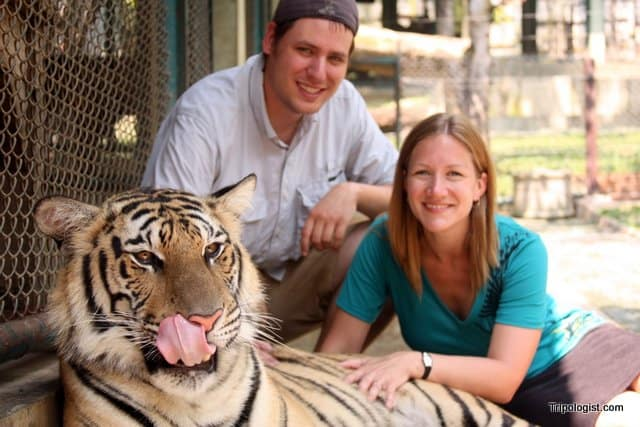 Posing with a two-year old tiger at Tiger Kingdom in Chiang Mai, Thailand.