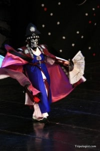 An actor performs the Bian Lian Mask Dance on the main stage at the Andong Mask Festival.