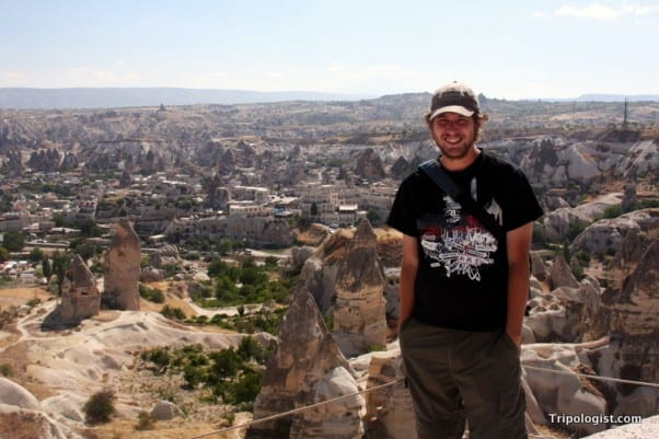 Standing on a cliff overlooking the fairy chimneys of Cappadocia.