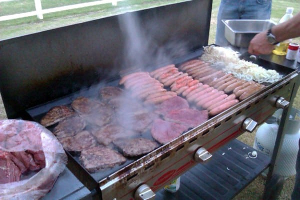 BBQ – Steaks and snags (sausages) cook on the barbie (barbeque).