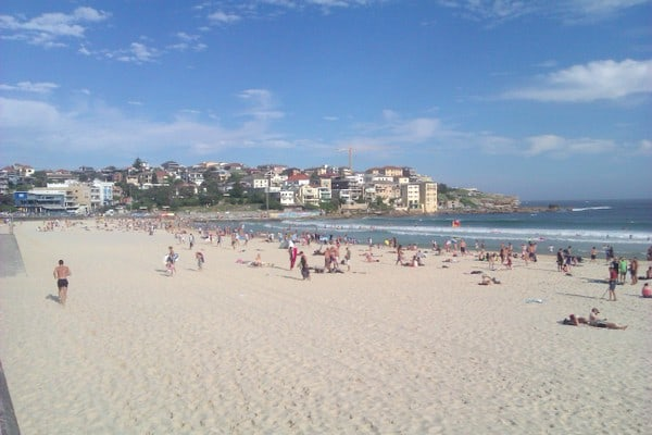 People play on Bondi Beach in Australia while taking a break from working in Australia.