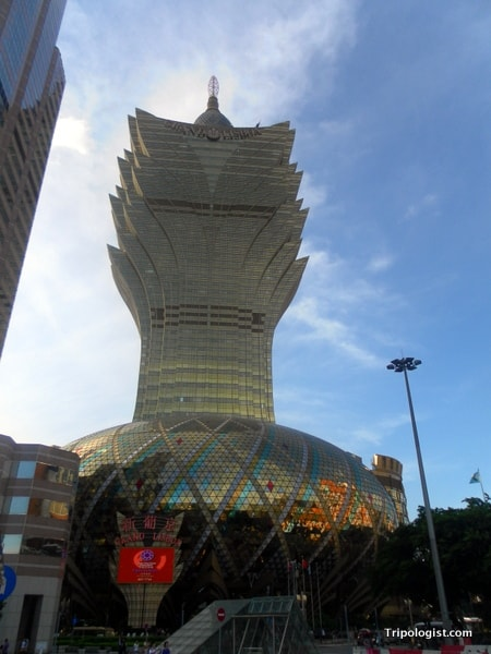 The gaudy Grand Lisboa Casino stands above the city of Macau. Gabling is one of the top things to do in Macau.