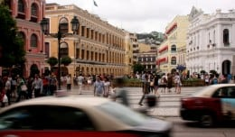Cars and people move past Largo de Senado, a great starting point for any day trip to Macau.