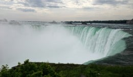Water crashing over the edge of Niagara Falls near the Visitors Center in Canada.