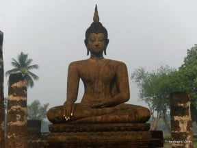 A seated Buddha at Wat Mana That in the Sukhothai Historical Park.