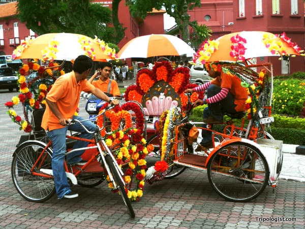 A group of tricked-out bicycle taxis wait for a fare in Dutch Square in Malacca's Chinatown.