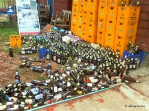 Beer bottles behind a hostel in Laos - Drinking every night is a great way to ruin your vacation.
