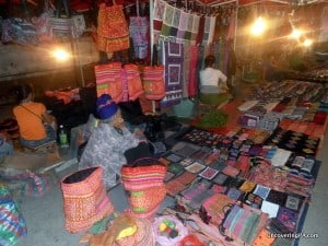 Haggling while shopping in local markets, like this one in Luang Prabang, Laos, can save you a lot of money.