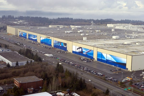 The outside of Boeing' Everett Factory, the largest building in the world by volume.