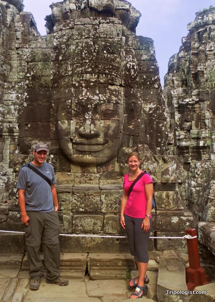 My wife and I with a stone face at Bayon Temple in Angkor Thom.