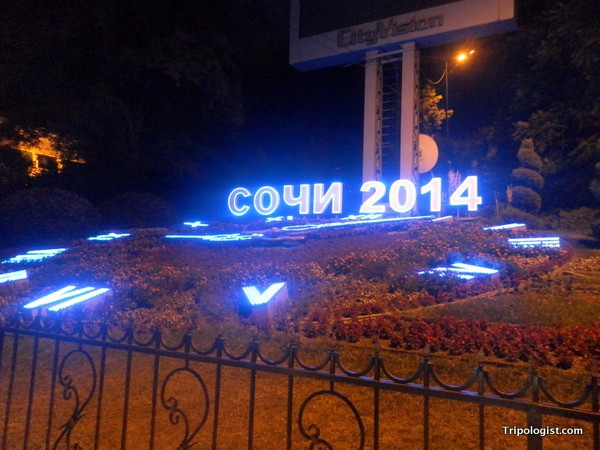 "A lit clock that reads ""Sochi 2014""."