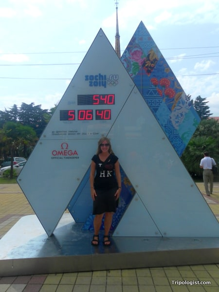 My wife posing in front of a sign counting down to the 2014 Winter Olympics.