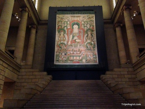 The giant Buddha banner on display in the Philadelphia Museum of Art.